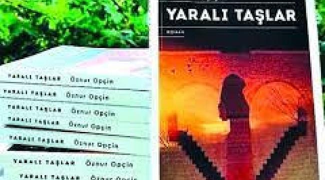 """YAZAR ÖZNUR OPÇİN """"YARALI TAŞLAR"""" ÇIKTI"""